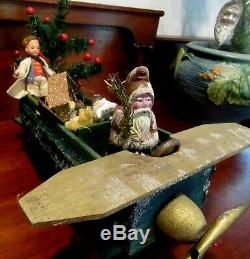 German Santa Claus with Feather Tree, Riding a Green Loofah Airplane with Toys