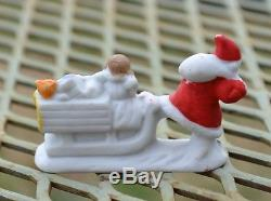 Rare Antique German Snow Baby Santa Claus with Sled and Toys Figurine