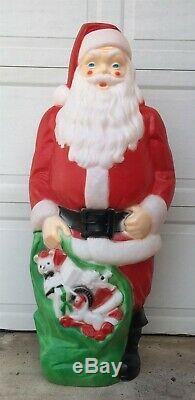 Santa Claus and his bag of Toys & Gifts 4 feet tall Blow Mold Yard Ornament
