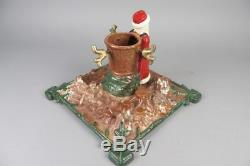 Vintage christmas tree stand with santa claus figure, cast iron