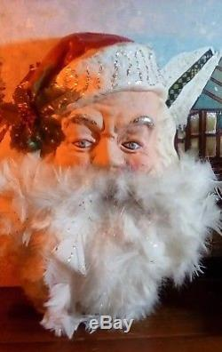 Vintage paper mache Santa Claus head blue eyes feathers