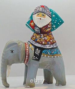 Wooden figure, this is amazing Santa Claus riding the Elephant